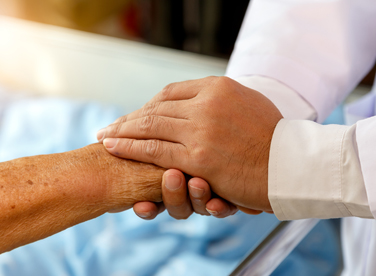 Provider holding patients hand