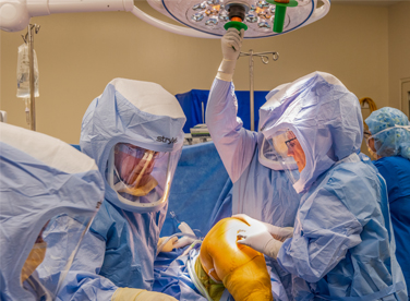 Photo of Dr. Mulroy doing knee surgery