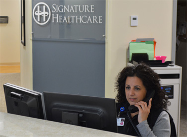 Signature Healthcare team member taking a call