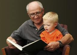 boy and grandfather reading